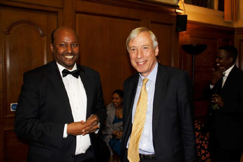Caption:- Minister of Defence and Deputy Speaker at the House of Lords, Rt Hon Earl Howe (right) with Abdirashid Duale.